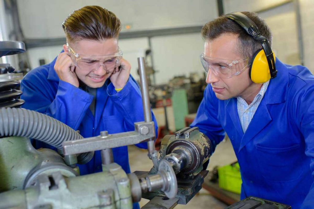 men working one with no ear protection