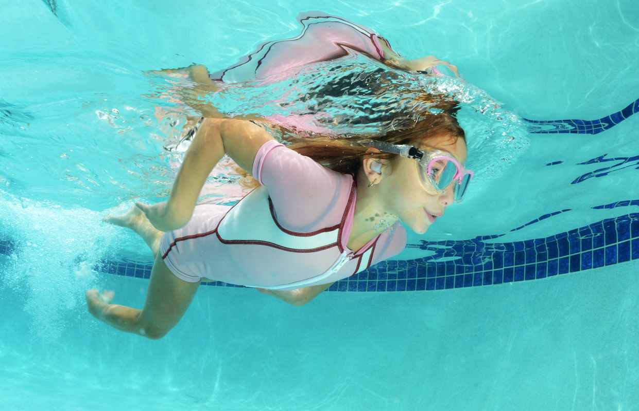 Kid girl swimming with Ear Protection0
