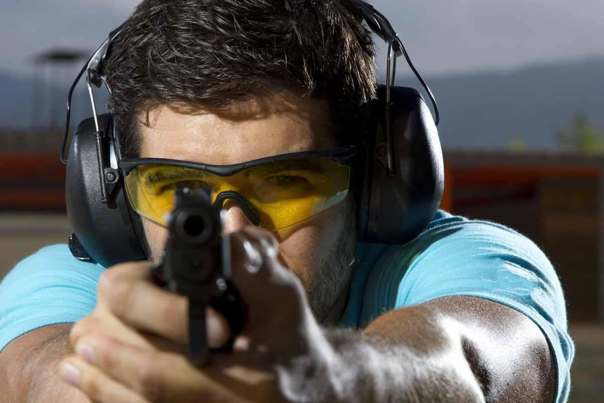 Man gun ear and eye protection0