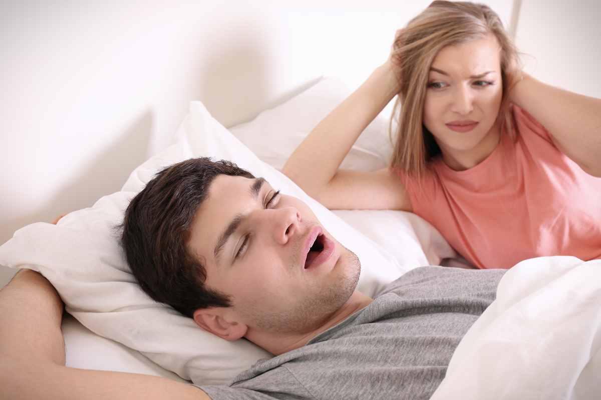 man snore woman awake0