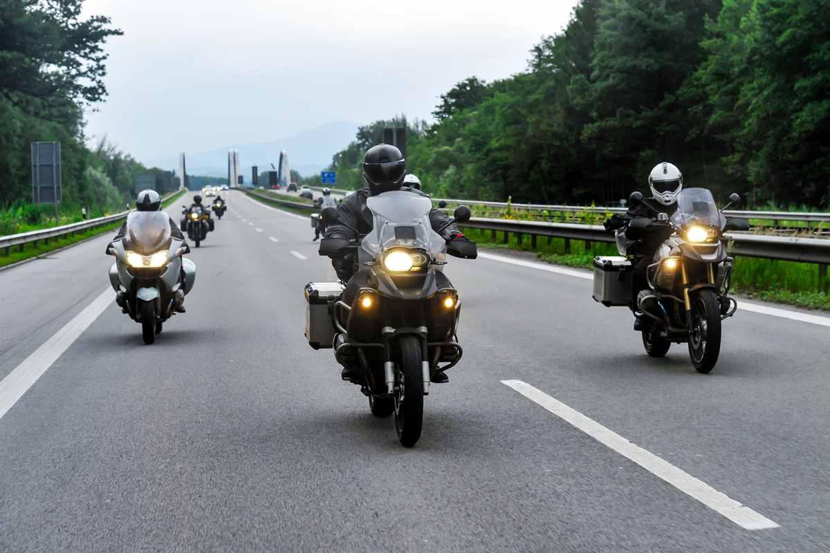 three motorcyclist0