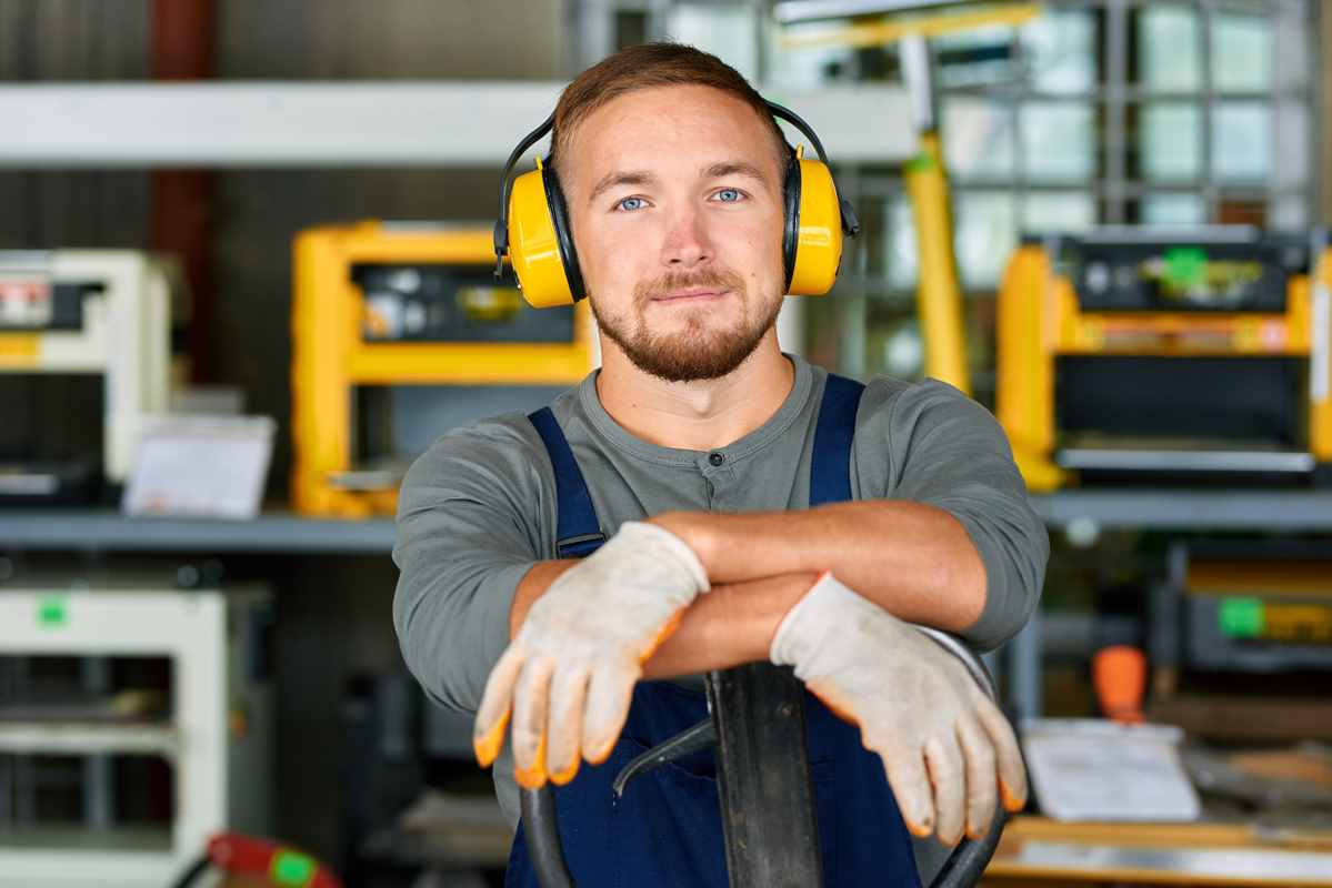 workman resting with ear protectors0